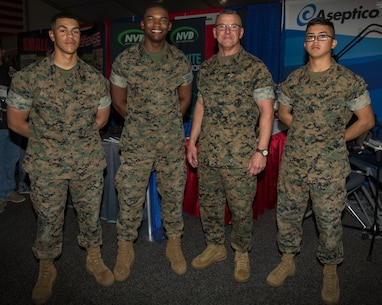 Lieutenant General Robert F. Hedelund, II Marine Expeditionary Force commanding general, poses for a photo with Marines during Marine South Expo 19 at Camp Lejeune, N.C., April 11, 2019. Marine South is an annual military exposition that provides a first-hand look at the latest technology, products and prototypes from the world's leading defense equipment manufacturers. The products showcased during the event are aimed toward preparing Marines to overcome the challenges of the modern battlefield. The expo is sponsored by the Marine Corps League, a Marine Corps veterans' association, and co-sponsored by Marine Corps Base Camp Lejeune. (U.S. Marine Corps photo by Cpl. Leynard Kyle Plazo)