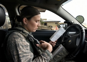 Airman 1st Class Abigail Biever, 56th Security Forces Squadron team member, radios in car mileage and vehicle conditions before the start of her shift April 11, 2019, at Luke Air Force Base Ariz.