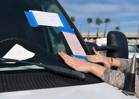 Airman 1st Class Abigail Biever, 56th Security Forces Squadron team member, leaves a vehicle notice and ticket on an abandoned vehicle April 11, 2019, at Luke Air Force Base Ariz.