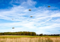 Members of the Special Operations Detachment – Europe and Co. C, 2nd Battalion, 19th Special Forces Group (Airborne), West Virginia National Guard, glide towards their landing site during static line and freefall operations Oct. 19, 2018, in Red House, Md. More than 50 Soldiers participated in multiple jump cycles throughout the day to maintain proficiency in jump operations. (National Guard photo by Bo Wriston)