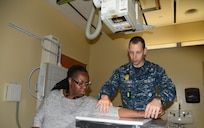 A corpsman at Naval Health Clinic Charleston x-rays the arm of a patient in this file photo. NHCC currently renders a wide range of quality health services for approximately 17,000  service members, family members and veterans at the Naval Weapons Station in Goose Creek.