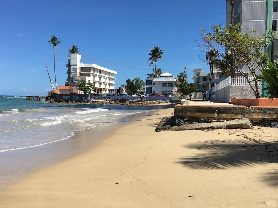 San Juan beach shore, buildings on the background in San Juan