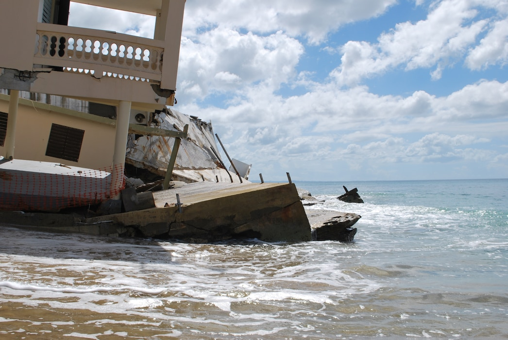 damage beach house partially submerged to the water in Rincon