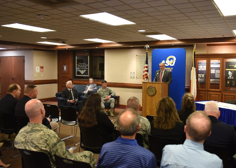 Chair Department of Security Studies and Criminal Justice Angelo State University Professor, Dr. Tony Mullins speaks to guests of the Memorandum of Understanding signing, which allows 14N professionals to transfer 12 credit hours toward two master's degree through Angelo State University at ASU, Texas, April 15, 2019. Over 115 14N professionals have transferred credits from Goodfellow courses to one of ASU's programs and over 60 have completed their master's degree. (U.S. Air Force photo by Airman 1st Class Zachary Chapman/Released)