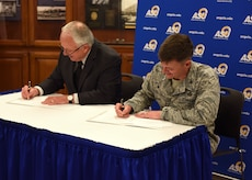 Angelo State University President, Dr. Brian May and U.S. Air Force Col. Thomas Coakley, 17th Training Group commander, sign a Memorandum of Understanding, at ASU, Texas, April 15, 2019. The MOUR allows 14N professionals to transfer 12 credit hours toward two master's degree through Angelo State University (U.S. Air Force photo by Airman 1st Class Zachary Chapman/Released)