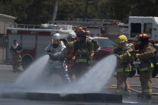 A team comprised of Central American firefighters douse a ground fire during the Central America Sharing Mutual Operational Knowledge and Experiences (CENTAM SMOKE) exercise, April 1, 2019, at Soto Cano Air Base, Honduras. CENTAM SMOKE brought together firefighters from Honduras, Costa Rica, Belize, Guatemala and El Salvador to train with U.S. Air Force members as well as develop bonds and understandings of one another's culture with team building exercises. The weeklong training included aircraft and structural fires, vehicle extrication, and a firefighter combat challenge. (U.S. Air Force photo by Staff Sgt. Eric Summers Jr.)