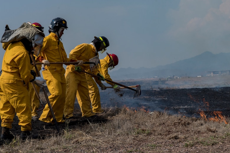 Central American firefighters plow the ground to contain a wildlands fire during the Central America Sharing Mutual Operational Knowledge and Experiences (CENTAM SMOKE) exercise, April 11, 2019, at Soto Cano Air Base, Honduras. CENTAM SMOKE brought together firefighters from Honduras, Costa Rica, Belize, Guatemala and El Salvador to train with U.S. Air Force members as well as develop bonds and understandings of one another's culture with team building exercises. The weeklong training included aircraft and structural fires, vehicle extrication, and a firefighter combat challenge. (U.S. Air Force photo by Staff Sgt. Eric Summers Jr.)