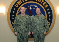 U.S. Navy Rear Adm. William Houston, left, deputy director of strategic targeting and nuclear mission planning, United States Strategic Command (USSTRATCOM), welcomes U.S. Navy Vice Adm. William Merz, deputy chief of naval operations for warfare systems (OPNAV N9), to USSTRATCOM headquarters, April 12, 2019. Merz conducted a Joint Maritime Fight briefing to USSTRATCOM personnel and was also the keynote speaker at the Heartland of America 119th Submarine Birthday Ball in downtown Omaha, Neb. The ball pays tribute to the men and women serving the submarine force, their families and all of those who came before them to take on the arduous task of undersea warfare that began when John Holland sold the submersible that would be commissioned USS Holland (SS-1) to the U.S. Navy, April 11, 1900.