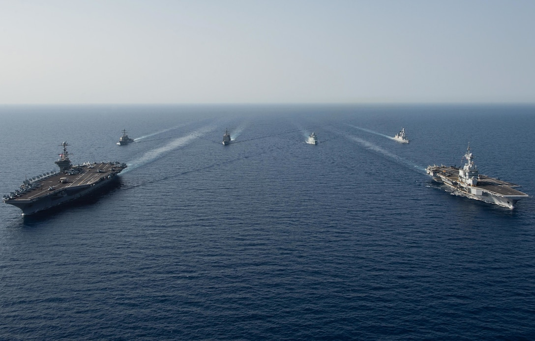 The aircraft carrier USS John C. Stennis (CVN 74), front left, The French Marine Nationale aircraft carrier FS Charles de Gaulle (F 91), front right, the guided-missile destroyer USS McFaul (DDG 74), the guided-missile cruiser USS Mobile Bay (CG 53), the Royal Danish navy frigate HDMS Niels Juel (F 363), and the French air defense destroyer FS Forbin (D 620) transit in formation in the Red Sea, April 15, 2019. The John C. Stennis Carrier Strike Group is deployed to the U.S. 5th Fleet area of operations in support of naval operations to ensure maritime stability and security in the Central Region, connecting the Mediterranean and the Pacific through the western Indian Ocean and three strategic choke points. (U.S. Navy photo by Mass Communication Specialist 3rd Class Skyler Okerman)