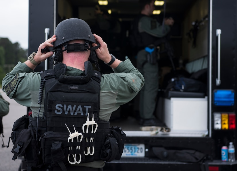 A member of the Charleston County S.W.A.T. team dons his gear for a joint training exercise with Citadel cadets and members of the 628th Security Forces Squadron April 12, 2019, on Naval Weapons Station Charleston, Joint Base Charleston, S.C.