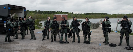 The Charleston County S.W.A.T. team dons their gear for a joint training exercise with Citadel cadets and the the 628th Security Forces Squadron April 12, 2019, on Naval Weapons Station Charleston, Joint Base Charleston, S.C.