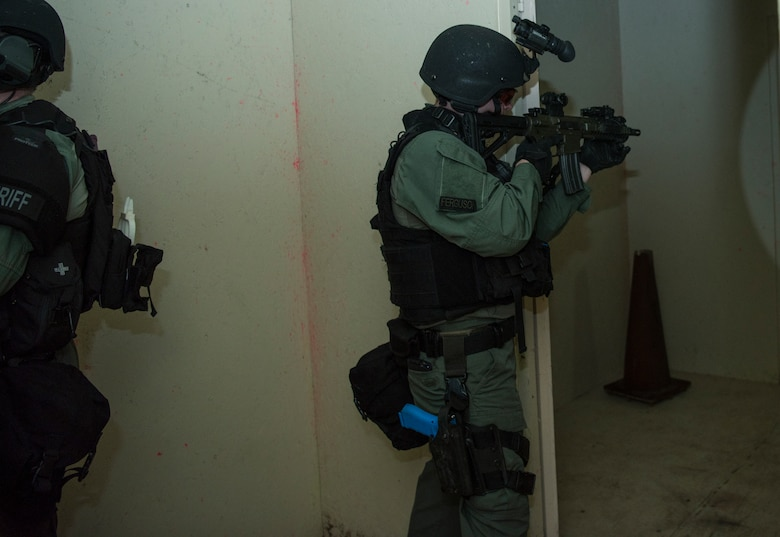 A member of the Charleston County S.W.A.T. team clears a room in a shoot house during a joint training exercise with Citadel cadets and members of the 628th Security Forces Squadron April 12, 2019, on Naval Weapons Station Charleston, Joint Base Charleston, S.C.
