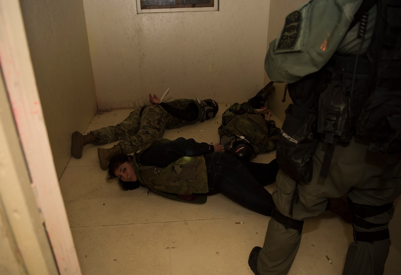 Simulated hostages are detained during a joint training exercise with the Charleston County S.W.A.T. team, Citadel cadets and the 628th Security Forces Squadron April 12, 2019, on Naval Weapons Station Charleston, Joint Base Charleston, S.C.