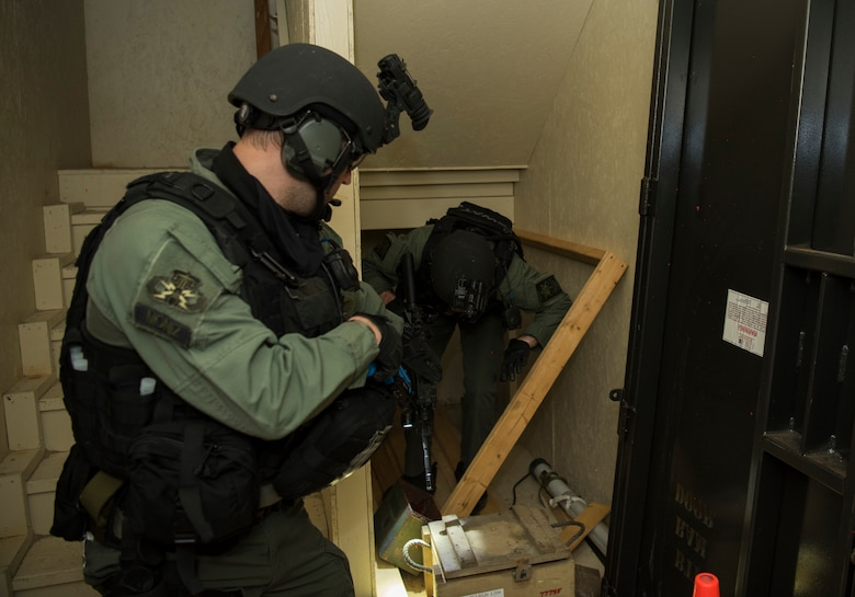 Members of the Charleston County S.W.A.T. team clear a room in a shoot house during a joint training exercise with Citadel cadets and members of the 628th Security Forces Squadron April 12, 2019, on Naval Weapons Station Charleston, Joint Base Charleston, S.C.