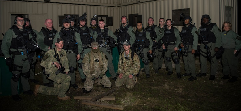 Members of the Charleston County S.W.A.T. team gather in front of a shoot house during a joint training exercise with Citadel cadets and the 628th Security Forces Squadron April 12, 2019, on Naval Weapons Station Charleston, Joint Base Charleston, S.C.