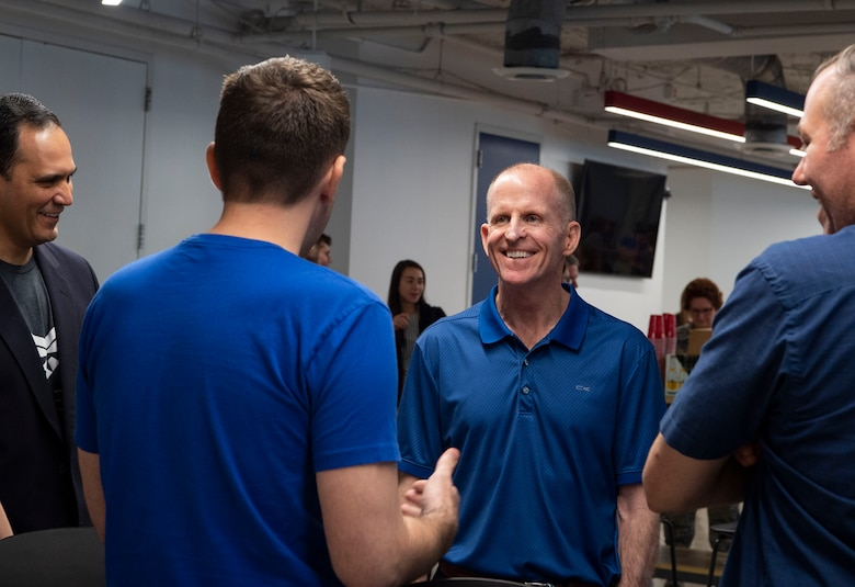 Air Force Vice Chief of Staff Gen. Stephen W. Wilson talks with Zach Walker, Defense Innovation Unit Texas lead at Capital Factory in Austin, Texas April 9, 2019.