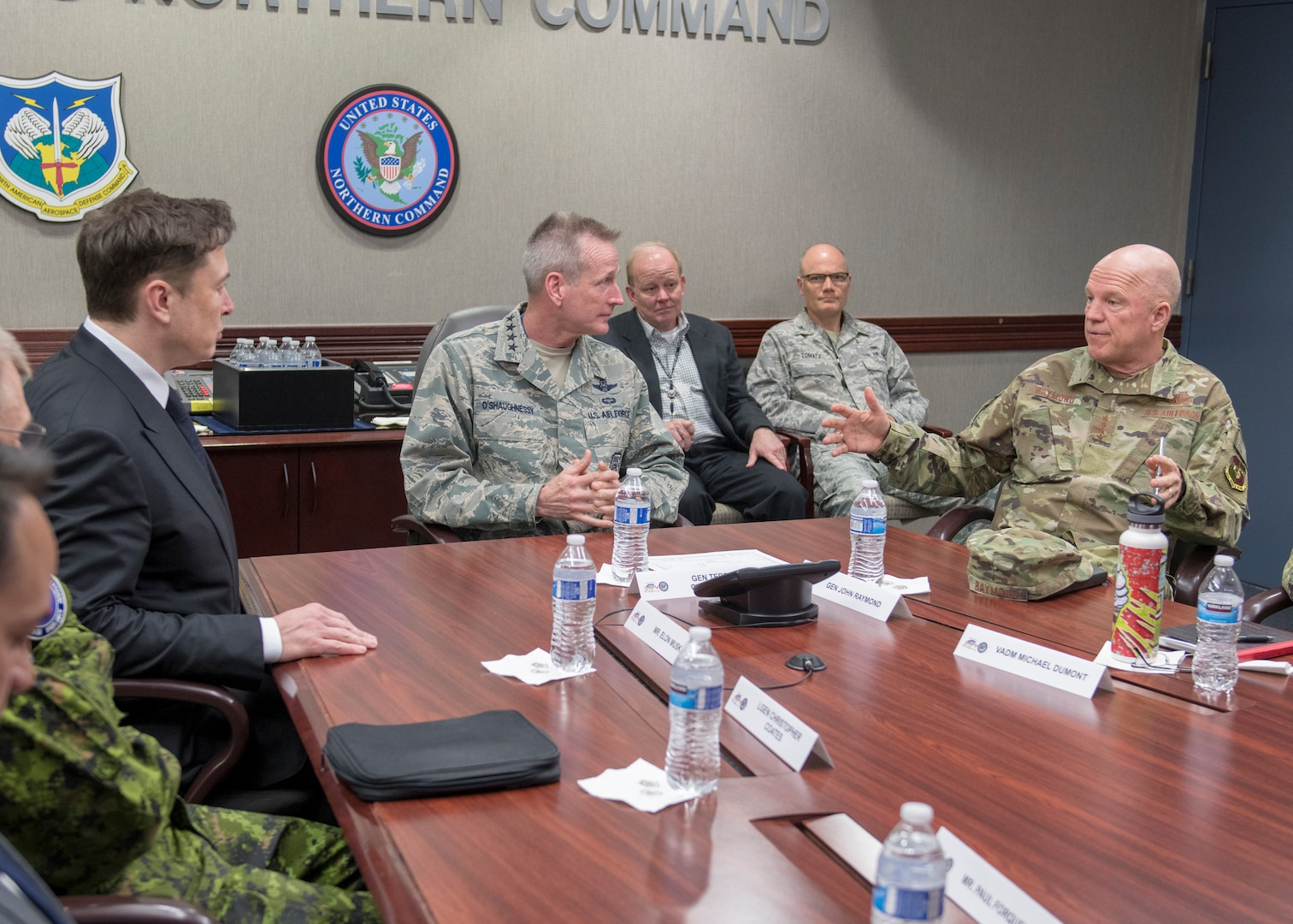 SpaceX CEO Elon Musk discusses U.S. space operations with Gen. Jay Raymond, the Commander, Air Force Space Command, and Joint Force Space Component Commander; and Gen Terrence O'Shaughnessy, the Commander of the North American Aerospace Defense Command and U.S. Northern Command, April 15, 2019. During Musk's visit to Colorado Springs, Colorado, he participated in conversations and round table briefings about future space operations and homeland defense innovation.