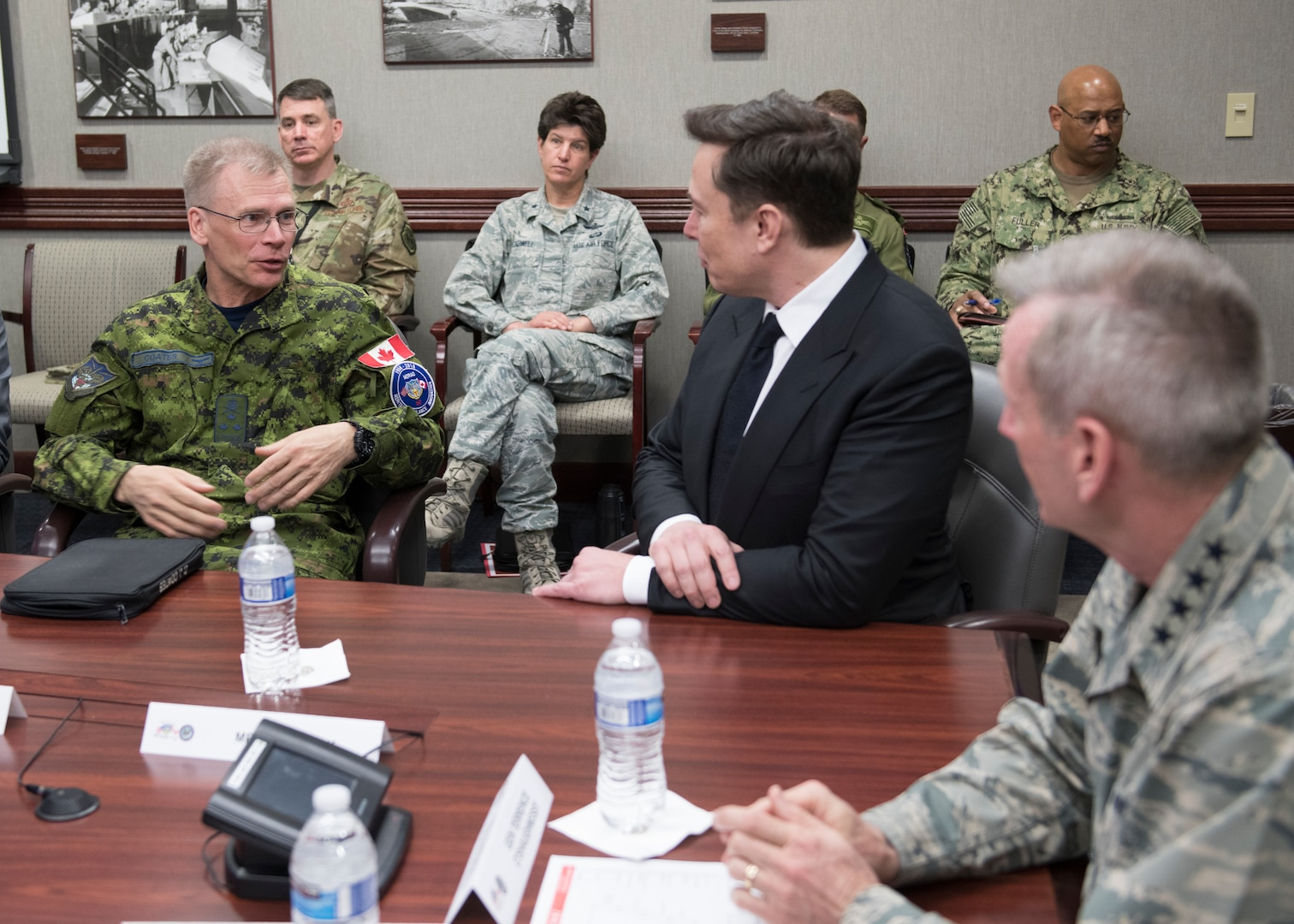 SpaceX CEO Elon Musk discusses U.S. space operations with Royal Canadian Air Force Lieutenant General Christopher Coates, the North American Aerospace Defense Command Deputy Commander and U.S. Air Force General Terrence O'Shaughnessy, the Commander of NORAD and U.S. Northern Command, April 15, 2019. During Musk's visit to Colorado Springs, Colorado he participated in conversations and round table briefings about future space operations and homeland defense innovation.