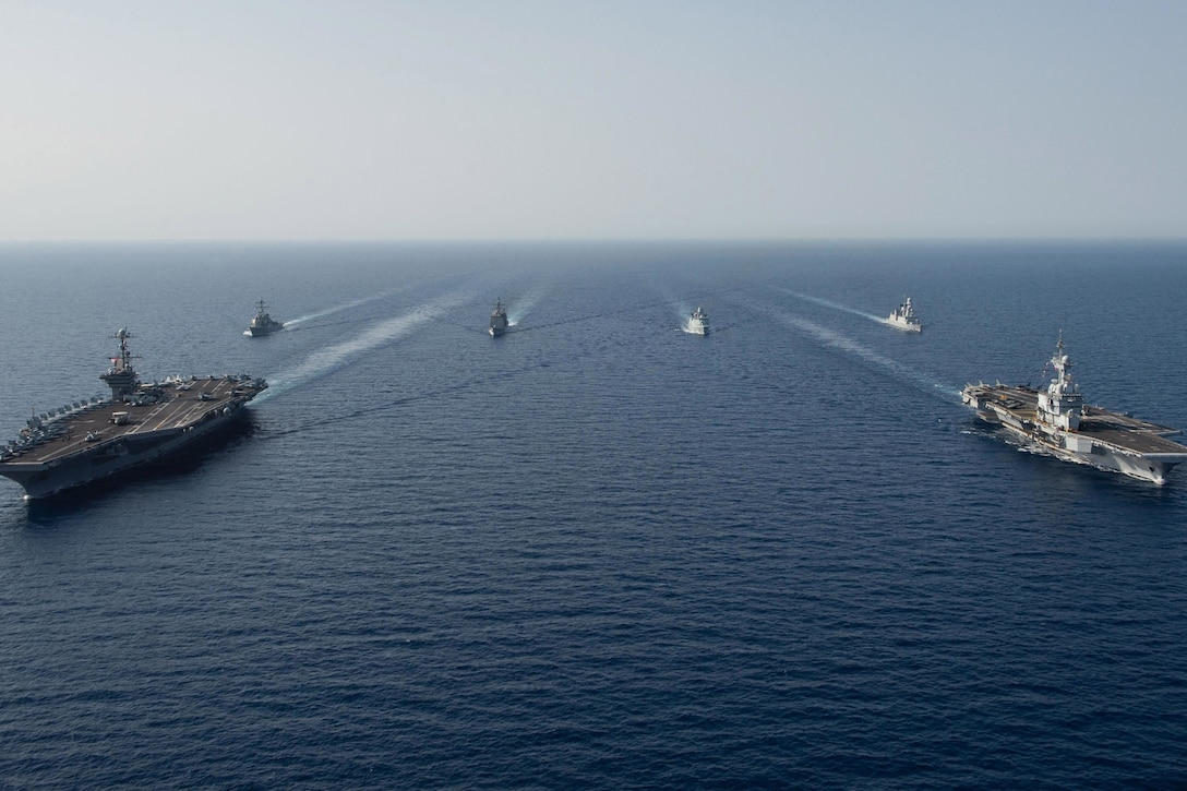 Six ships travel in formation.