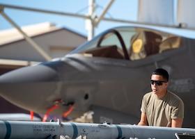 Airman 1st Class Talon Nichols, 62nd Aircraft Maintenance Unit weapons load crew member, prepares munitions to be loaded onto an F-35A Lightning II, April 11, 2019, at Luke Air Force Base, Ariz.
