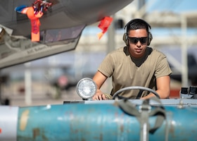 Airman 1st Class Talon Nichols, 62nd Aircraft Maintenance Unit weapons load crew member, drives a jammer during the 1st quarter Load Crew Competition, April 11, 2019, at Luke Air Force Base, Ariz.