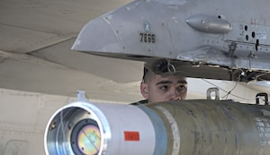 Airman 1st Class Justin Duran, 310th Aircraft Maintenance Unit weapons load crew member, prepares munitions on an F-16 Fighting Falcon during the 1st Quarter Load Crew Competition, April 11, 2019, at Luke Air Force Base, Ariz.
