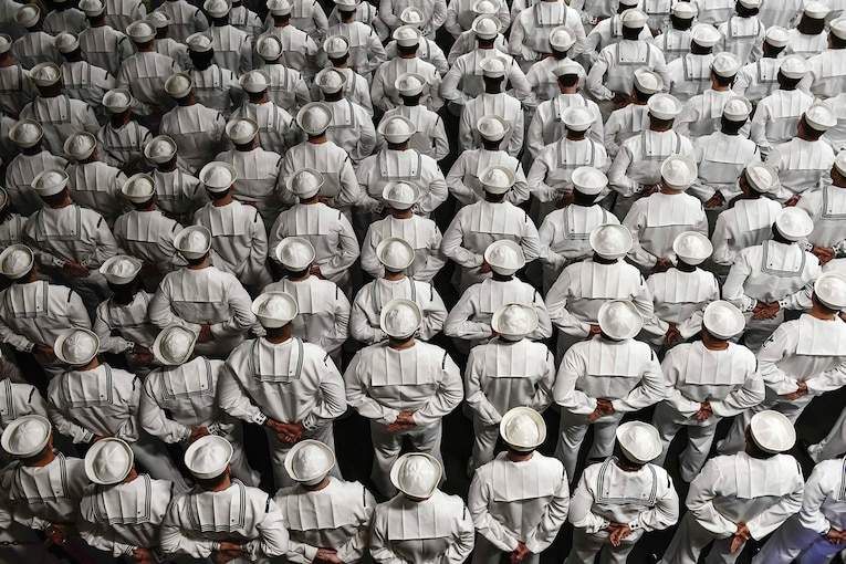 Sailors stand during a change-of-command ceremony.