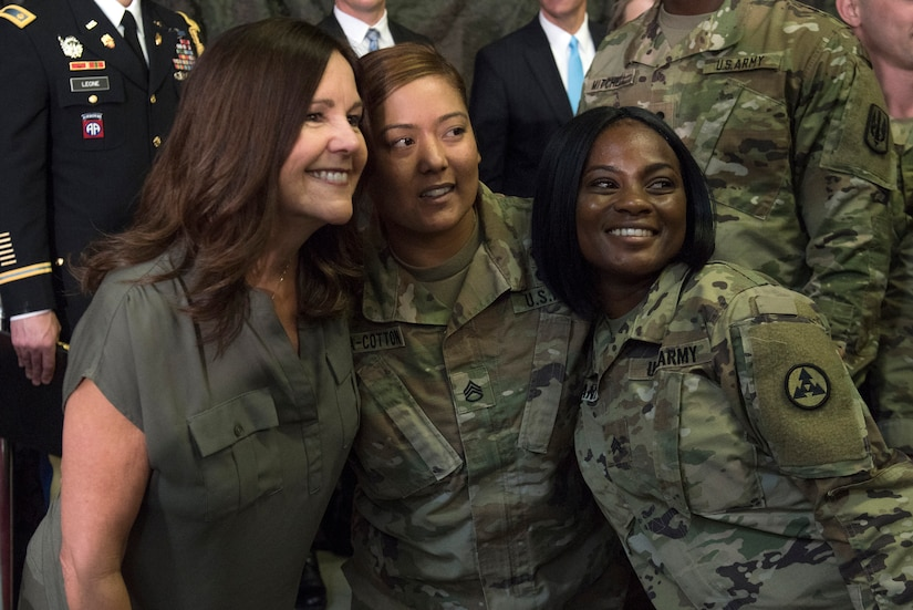 Karen Pence take a photo with soldiers.