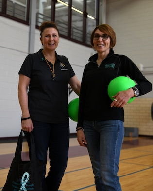 PETERSON AIR FORCE BASE, Colo.- Lorinda Pirrie (left), the sexual assault response coordinator (SARC) and Sherri Giulio, a victim's advocate from the sexual assault prevention and response (SAPR) office, in Peterson AFB, Colo. host a dodgeball event to spread sexual assault and harassment awareness April 5, 2019, in Peterson AFB, Colo. This was the third annual Sexual Assault and Awareness month dodgeball tournament that the SAPR office has hosted. (U.S. Air Force photo by Airman 1st Class Andrew Bertain)