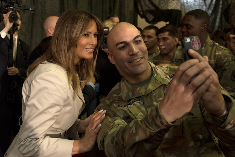 Melania Trump poses for a selfie with a soldier.