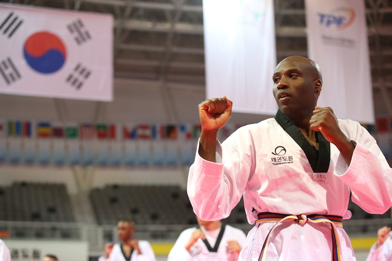 Antwaun Parrish, an U.S. Army Corps of Engineers, Far East District public affairs specialist, conducts Taekwondo training during a cultural exchange event hosted by The Republic of Korea (ROK), Ministry of National Defense at Taekwondowon, Muju, South Korea, April 9-11.