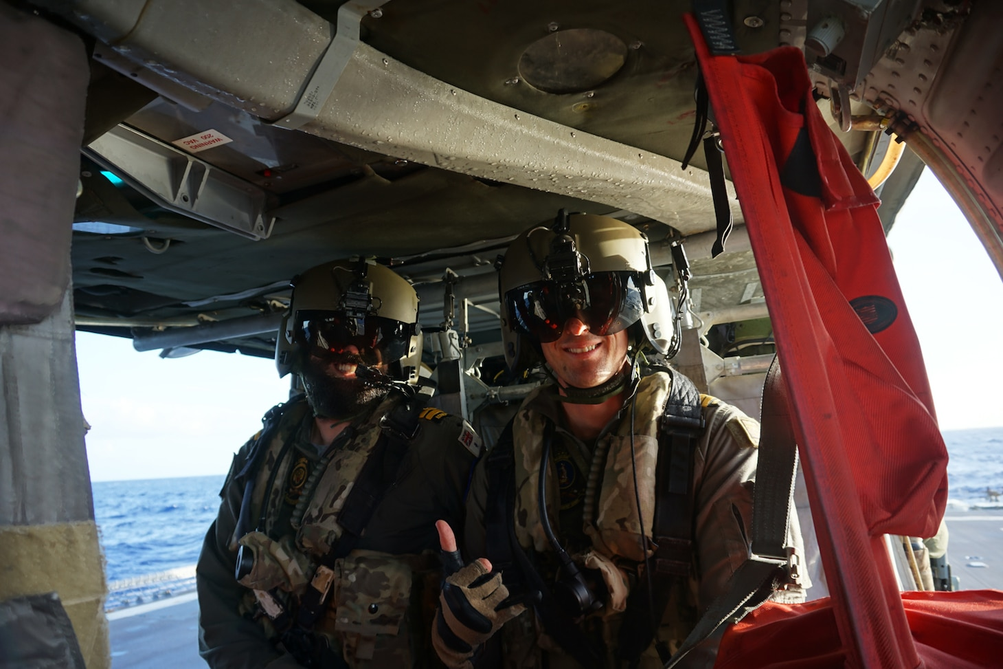 Senior leaders from Royal Australian Navy guided-missile frigate HMAS Melbourne (FFG 05) and Helicopter Sea Combat Squadron (HSC) 25 pause for a photo during visit conducted in conjunction with deck landing qualifications between the two units.  HSC-25 provides a multi-mission rotary wing capability for units in the U.S. 7th Fleet area of operations and maintains a Guam-based 24-hour search-and-rescue and medical evacuation capability, directly supporting U.S. Coast Guard and Joint Region Marianas. HSC-25 is the Navy's only forward-deployed MH-60S expeditionary squadron.