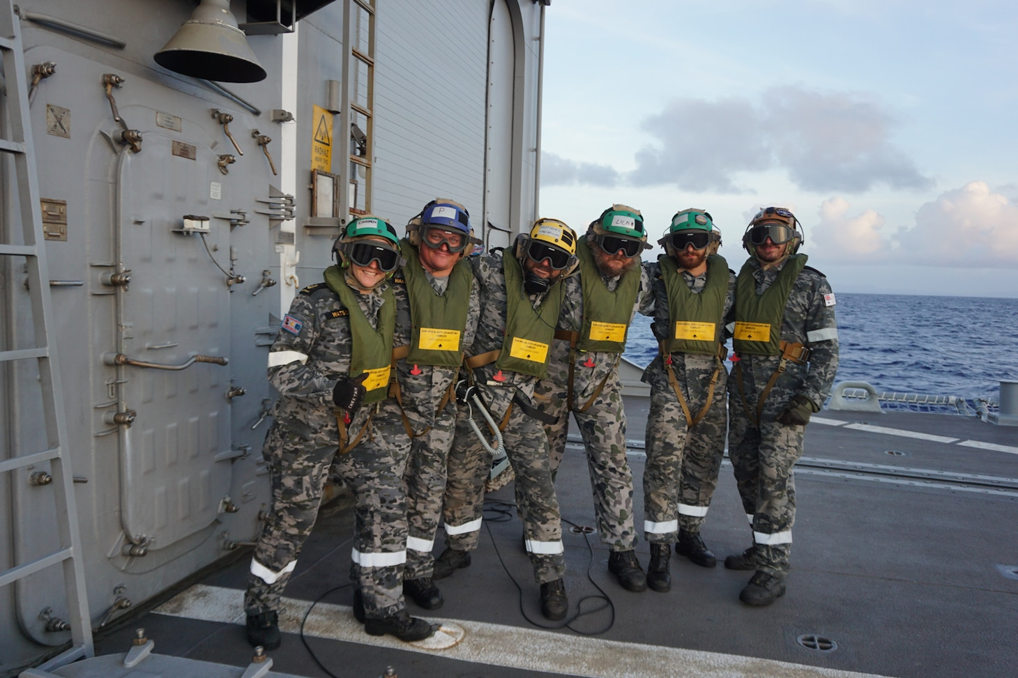 """The flight deck crew of the Royal Australian Navy guided-missile frigate HMAS Melbourne (FFG 05) chock and chain an MH-60S Sea Hawk helicopter, assigned to the """"Island Knights"""" of Helicopter Sea Combat Squadron (HSC) 25 to Melbourne's flight deck. HSC-25 provides a multi-mission rotary wing capability for units in the U.S. 7th Fleet area of operations and maintains a Guam-based 24-hour search-and-rescue and medical evacuation capability, directly supporting U.S. Coast Guard and Joint Region Marianas. HSC-25 is the Navy's only forward-deployed MH-60S expeditionary squadron."""