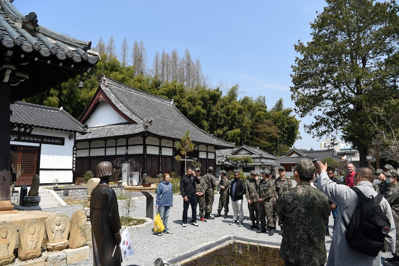 Republic of Korea Air Force Capt. Sungcheol Lee, 38th Fighter Group chaplain, talks about the differences between Japanese and Korean Buddhist temples at Dongguksa Temple in Gunsan City, Republic of Korea, April 13, 2019. Lee explained that the Japanese architectural style shows wood in a more natural state, while Korean style features colorful designs on the wood. (U.S. Air Force photo by Staff Sgt. Joshua Edwards)