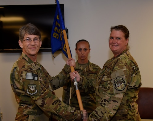 Lt. Col. Carolyn Dale accepts the guidon during an Assumption of Command ceremony held at MacDill Air Force Base, April 6. Dale had been the deputy squadron commander and chief flight nurse at the 45th AES prior to taking command. (U.S. Air Force Photo by Staff Sgt. Nicholas Monteleone)