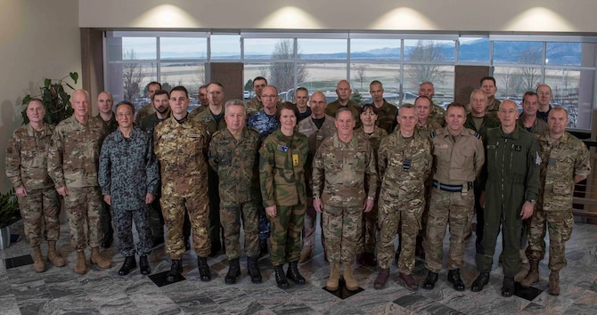 Air Force Chief of Staff Gen. David L. Goldfein (center) stands with air chiefs and senior staff from Australia, Canada, Denmark, France, Germany, Italy, Japan, Netherlands, New Zealand, Norway and the United Kingdom, April 11, 2019, during the first joint meeting of the chiefs to discuss operations in space in Colorado Springs, Colo.