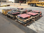 Contractors prepare to transport more than 14,000 pounds of lead acid batteries from Thumrait Air Base to a recycling facility in Oman.