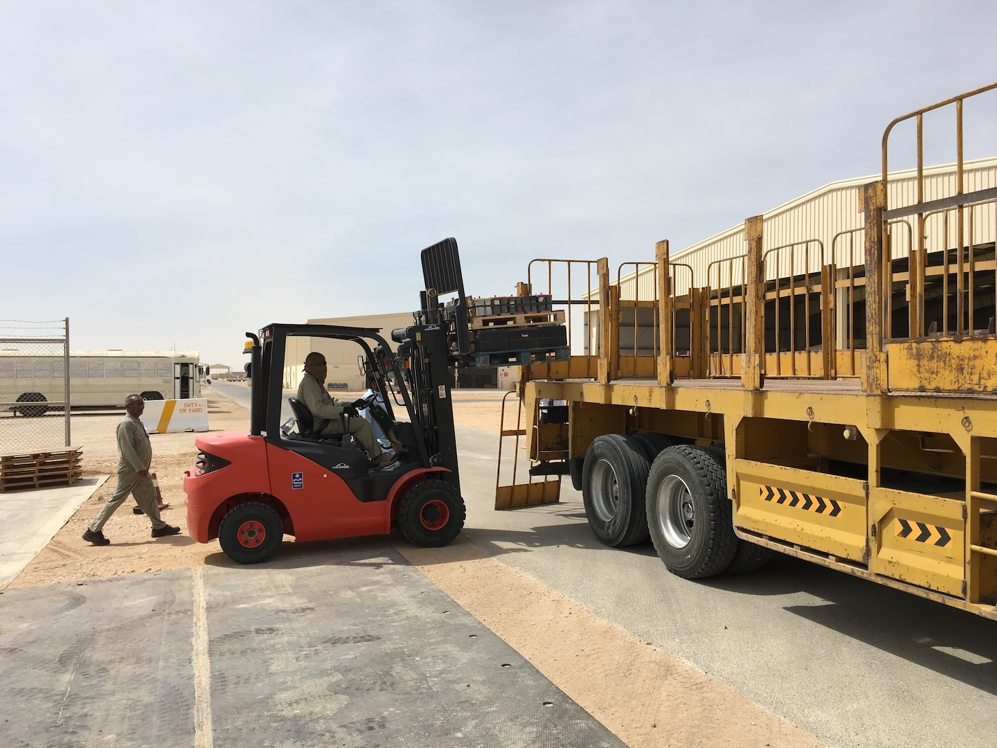 Contractors load of lead acid batteries for their journey from Thumrait Air Base to a recycling facility in Oman.