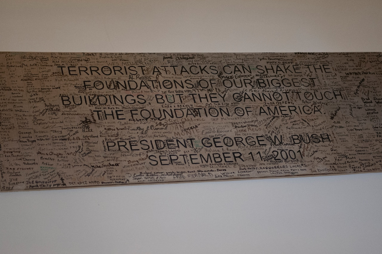 A plaque with an inspirational quote is surrounded by signatures.