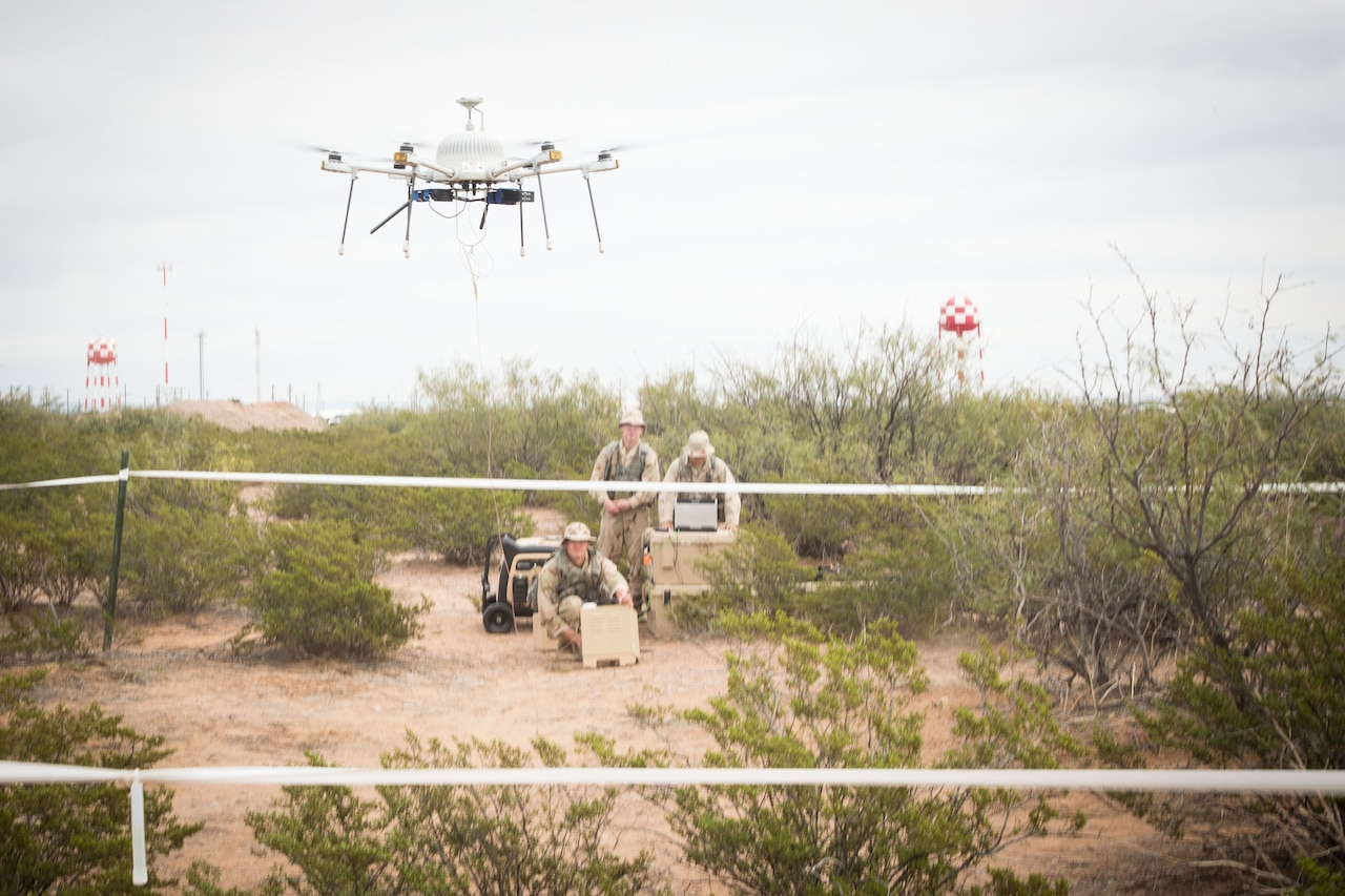 Soldiers operate drones.