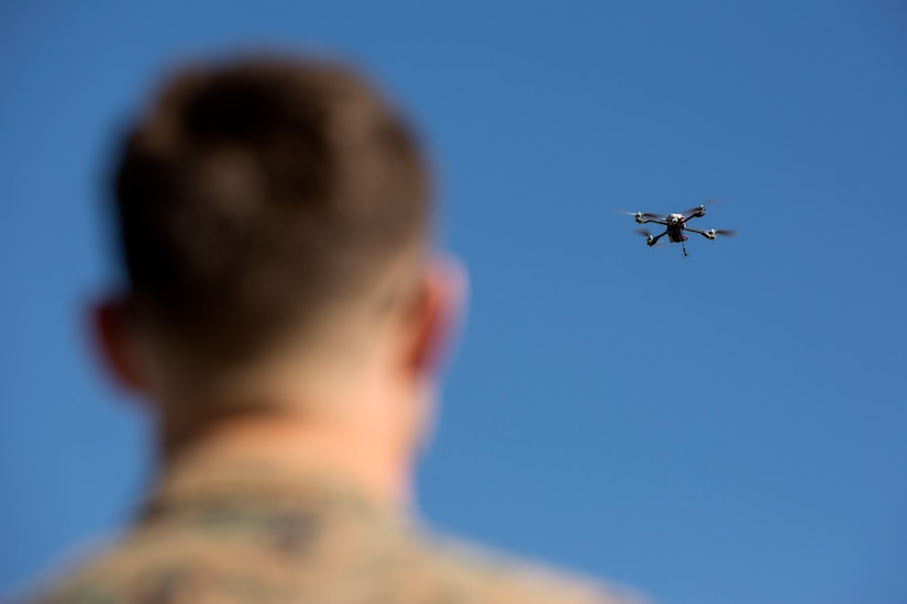 A Marine flies drone.