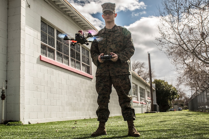 A Marine tests a drone.