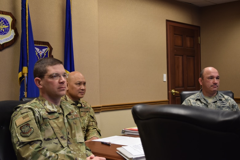 Lt Col Frank Theising 375th Communications Squadron Commander, Brig Gen Jimmy Canlas 618th Air Operations Center Commander, and Col Kyle Mikos Air Mobility Command Director of Cyberspace Forces were briefed at the conclusion of the exercise.