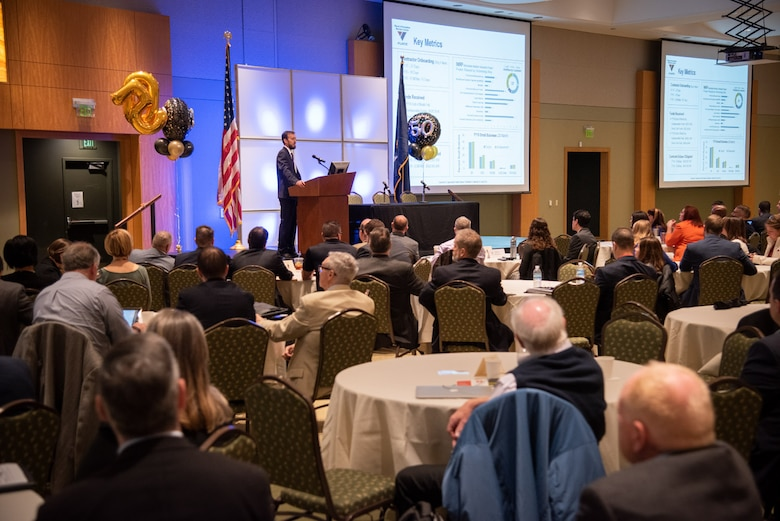 Naval Information Warfare Center (NIWC) Atlantic Executive Director Chris Miller speaks during the 50th Small Business Industry Outreach Initiative April 2, 2019, at Trident Technical College in Charleston, S.C.