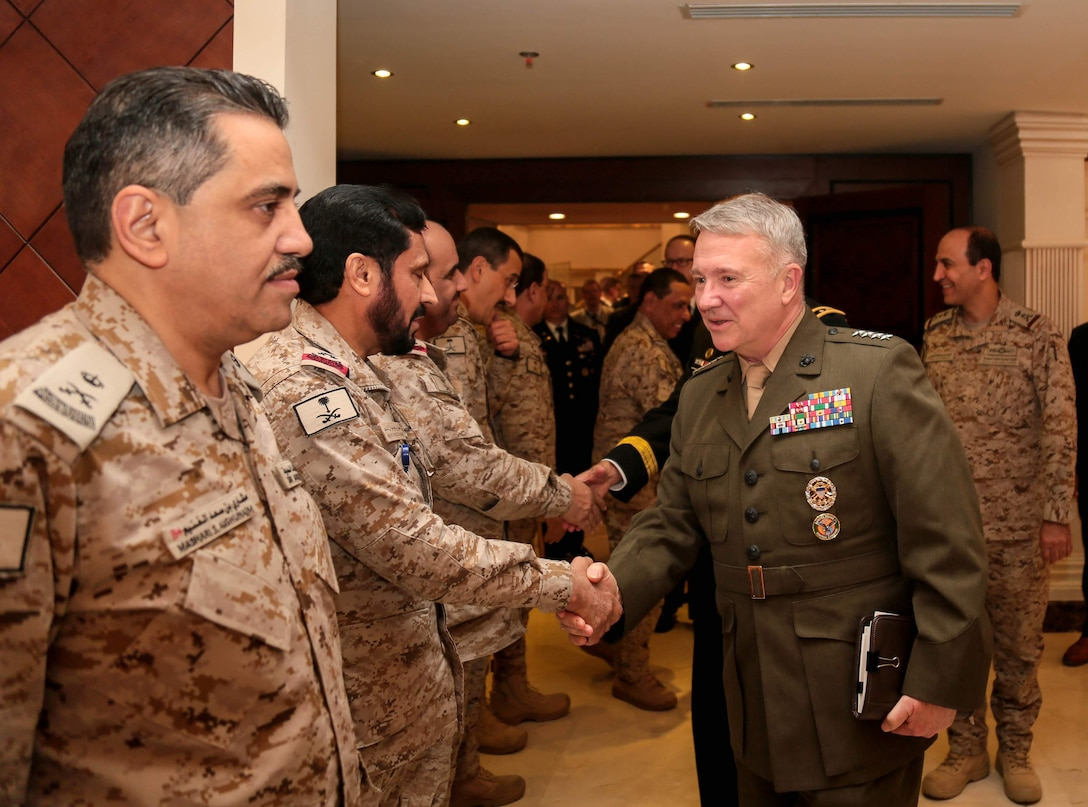 U.S. Marine Corps Gen. Kenneth F. McKenzie Jr., U.S. Central Command commander, greets Saudi Arabia National Gaurd service members after meeting with King of Saudi Arabia, Salman bin Abdulaziz Al Saud, during his visit to Saudi Arabia, April 15, 2019. This meeting allowed McKenzie to reinforce mil-to-mil relationships between the partner countries, develop continued strategies to counter extremist networks, and gain a better understanding of current operations within the USCENTCOM area of operation. (U.S. Army photo by Sgt. Franklin Moore)