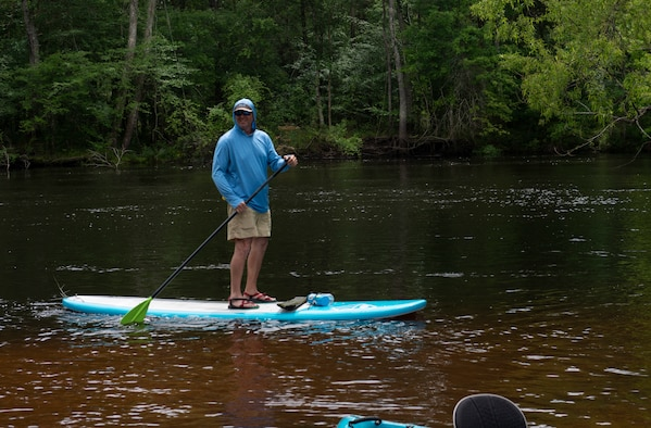 Earl Johnston, kayaking instructor, paddle boards on Black River near, Ridgeville, S.C., April 13, 2019.