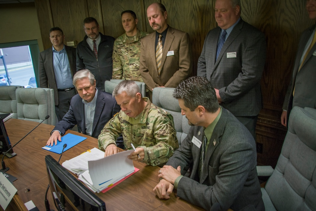chief of engineers signs papers with senator hoeven and federal and local officials