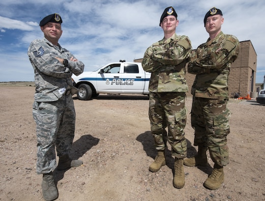 Tech. Sgt. Jason Kadisak, 50th Security Forces Squadron standards and evaluation noncommissioned officer in charge, left, Staff Sgt. Chances Dobbins, 50th SFS standards and evaluation evaluator, middle, and Senior Airman Cody Bilgers, 50th SFS standards and evaluation evaluator,right, stand ready at the 50th SFS headquarters at Schriever Air Force Base, Colorado, April 16, 2019. The flight's evaluations determine a Defender's knowledge of their mission, while reviewing methods in place to identify future change and innovation. (U.S. Air Force photo by Staff Sgt. Matthew Coleman-Foster)