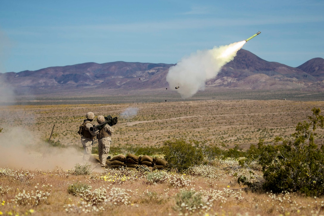 Two Marines fire a missile.