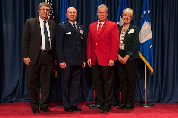 DAYTON, Ohio – David Hills (red jacket) received the 2018 Director's Award for Volunteer of the Year for his dedication and excellence in serving the National Museum of the U.S. Air Force. (from left to right) Museum Director David Tillotson III, Maj. Gen. Carl E. Schaefer Deputy Commander, Air Force Materiel Command, Volunteer David Hills, and Air Force Museum Foundation Board of Trustees President Col.(Ret.) Susan E. Richardson. (U.S. Air Force photo)